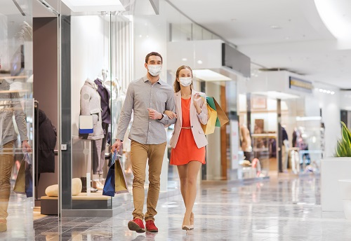 Couple shopping at mall with masks on
